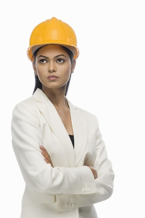 asian architect: Close-up of a female architect with her arms crossed