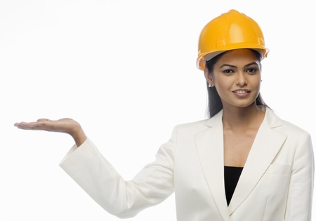 Portrait of a female architect showing her palm Stock Photo