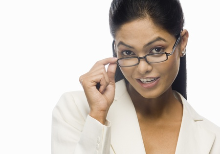 Portrait of a curious businesswoman holding her eyeglasses LANG_EVOIMAGES