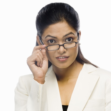 rfbatch15: Portrait of a curious businesswoman holding her eyeglasses LANG_EVOIMAGES
