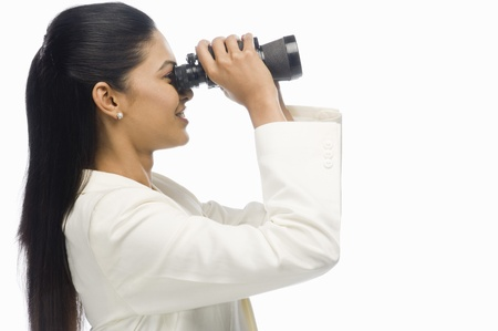 corporate culture: Businesswoman looking through binoculars