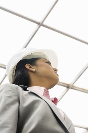 architect: Female architect looking up