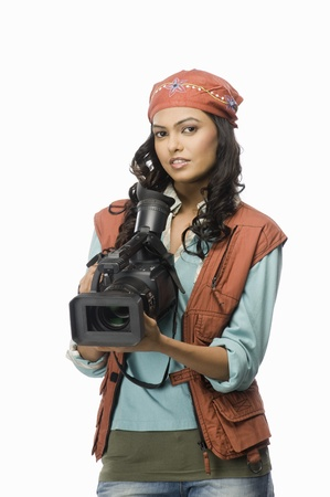 rfbatch15: Portrait of a female videographer with video camera LANG_EVOIMAGES