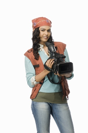 photosindia: Portrait of a female videographer with video camera LANG_EVOIMAGES