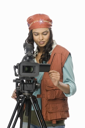 fully unbuttoned: Female videographer videographing