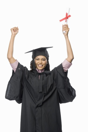 rfbatch15: Portrait of a female graduate cheering with her diploma LANG_EVOIMAGES