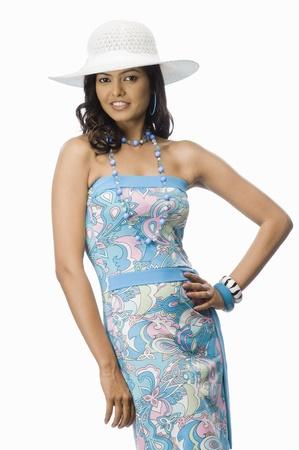 photosindia: Portrait of a female fashion model posing against white background
