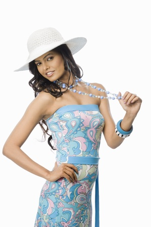 rfbatch15: Portrait of a female fashion model posing against white background