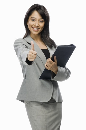 x files: Portrait of a businesswoman holding a file and showing thumbs up