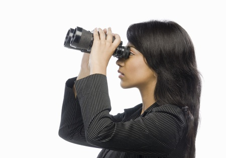 corporate espionage: Businesswoman looking through binoculars