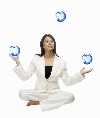 地球儀をジャグリング実業家 写真素材