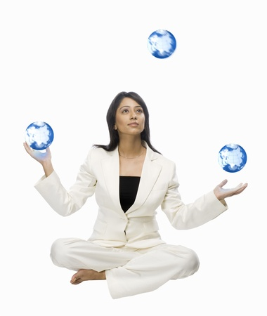 Businesswoman juggling globes Stock Photo - 10123458