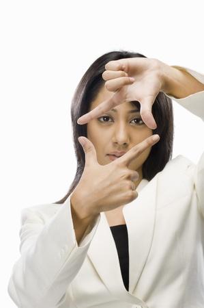 Businesswoman making finger frame