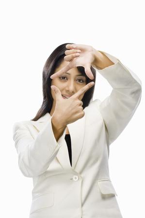 Businesswoman making finger frame Stock Photo - 10126254