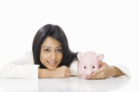 Portrait of a businesswoman with a piggy bank Stock Photo - 10123522