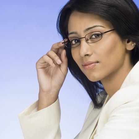 beh�rde: Portrait of a Businesswoman holding ihre Brillen