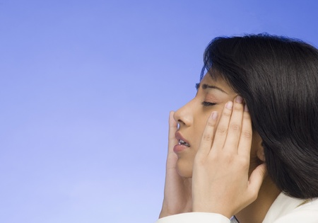wearying: Frustrated businesswoman with her head in her hands