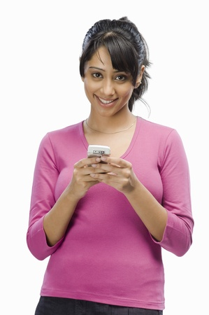 Portrait of a young woman text messaging Stock Photo - 10126038