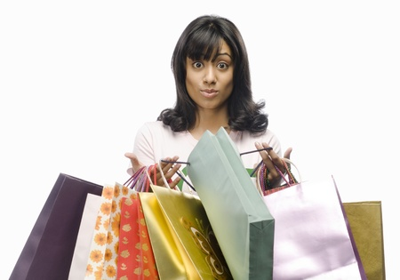 Surprised young woman carrying shopping bags Stock Photo - 10123555