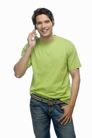 Portrait of a young man talking on a mobile phone Stock Photo - 10126113
