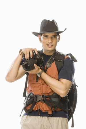 Portrait of a young male photographer holding a digital camera Stock Photo - 10123592