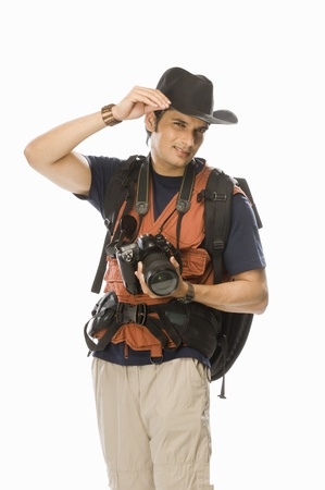 Portrait of a young male photographer holding a digital camera Stock Photo - 10126219