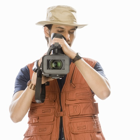 Young male videographer holding a videography camera Stock Photo - 10123613