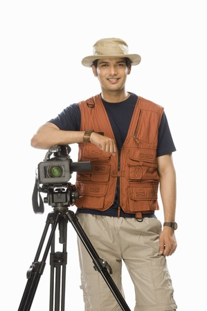 Portrait of a young male videographer holding a videography camera Stock Photo - 10126204