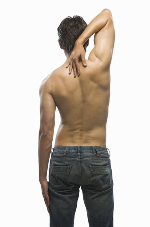 Rear view of a young man suffering from backache Stock fotó