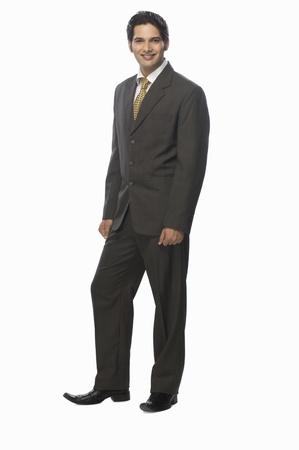 Portrait of a businessman standing against a white background Banque d'images