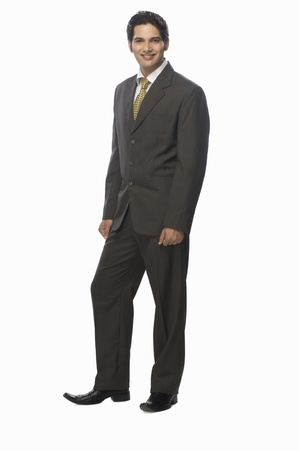 Portrait of a businessman standing against a white background Stock Photo - 10123469