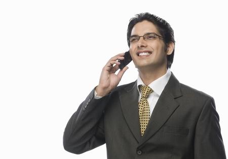 Empresario hablando por un tel�fono m�vil Foto de archivo - 10123649