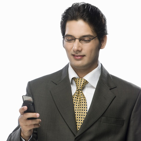 Businessman looking at a mobile phone Stock Photo - 10123792