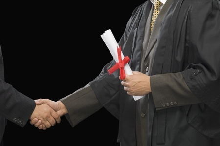 Close-up of two businessmen shaking hands Stock Photo