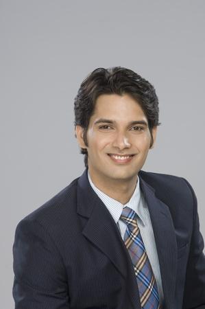 Portrait of a businessman smiling Stock Photo - 10125991