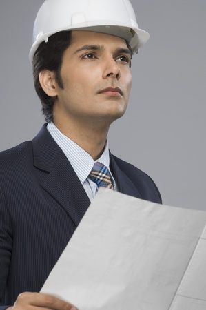 Close-up of a young male architect holding a paper Stock Photo - 10126067