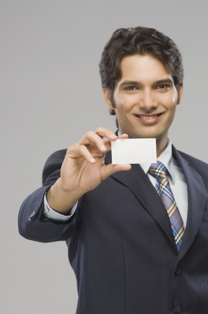 Portrait of a businessman showing a business card Stock Photo - 10123668