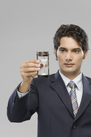 Close-up of a businessman looking at an hourglass Stock Photo - 10126083