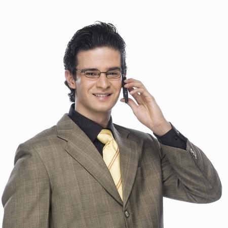 photosindia: Portrait of a businessman talking on a mobile phone