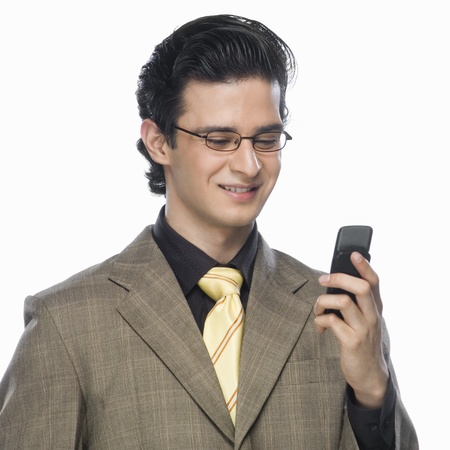 clipping  messaging: Close-up of a businessman looking at a mobile phone