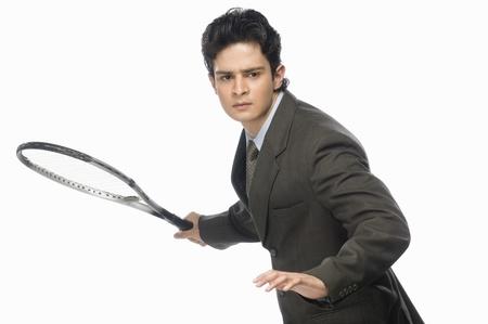 Businessman playing tennis Stock Photo - 10126265
