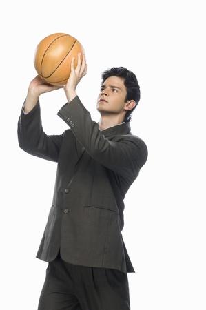 Businessman playing basket ball Stock Photo - 10123660