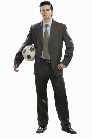 rfbatch15: Portrait of a businessman holding a soccer ball LANG_EVOIMAGES