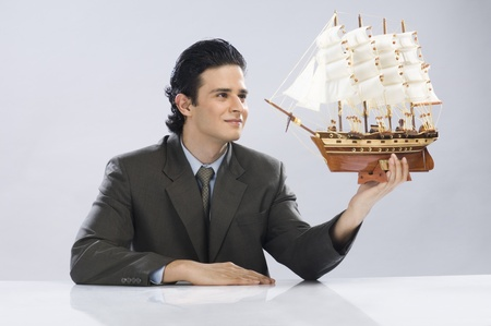 rfbatch15: Businessman looking at a sailing ship LANG_EVOIMAGES