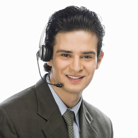 service desk: Portrait of a male customer service representative smiling LANG_EVOIMAGES