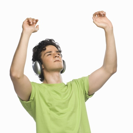 rfbatch15: Man listening to music with his hands raised