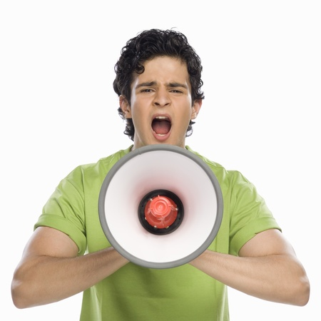 assertive: Man holding a megaphone and shouting