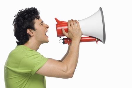 Man holding a megaphone and shouting Stock Photo - 10126232