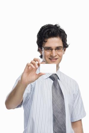 photosindia: Portrait of a businessman showing a blank business card