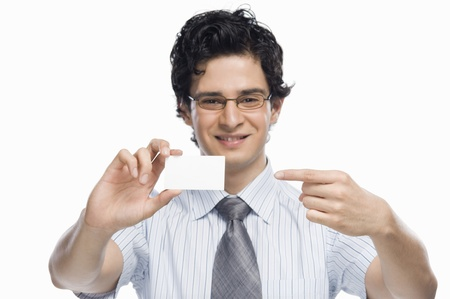 Portrait of a businessman showing a blank business card